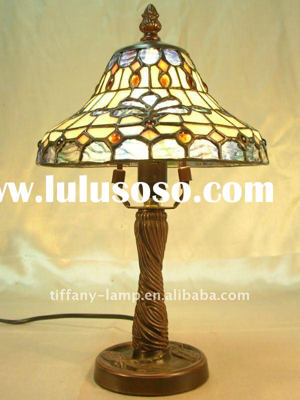 Antique stained glass lamp shade in metal dragonfly base