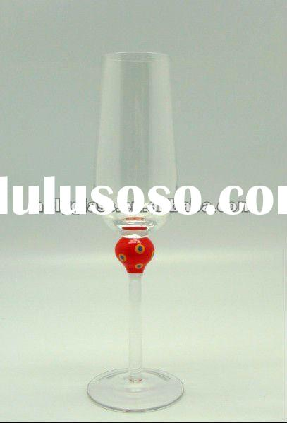 clear champagne glass with red ball on the stem