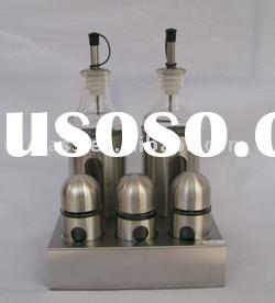 glass oil and spice bottles with stainless steel stand