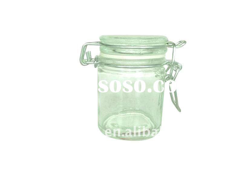 small round glass jar with clip glass lid
