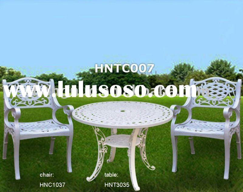 White Plastic Outdoor Table and Chair with pattern at the table top & arm chair
