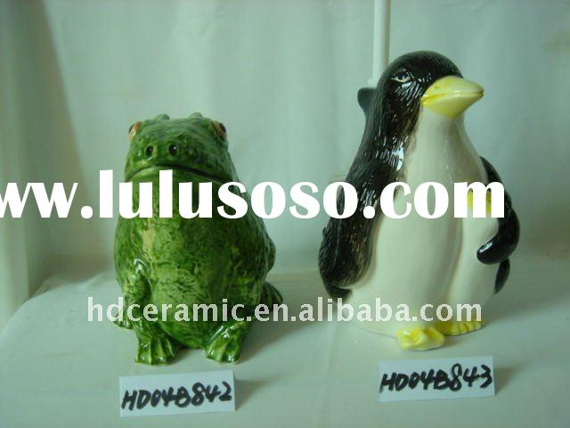 Ceramic toilet brush holder with penguin statue