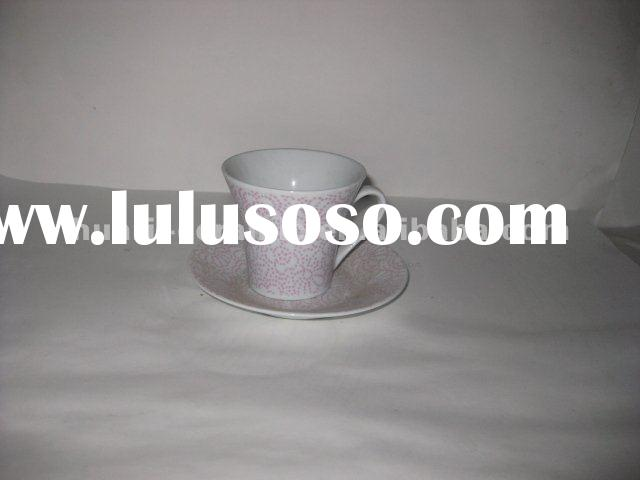 White ceramic tea cup and saucer with flower pattern