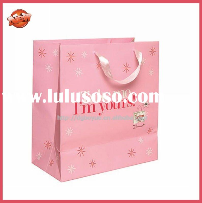printing pink boutique paper gift bags with pink silk ribbon and custom logo