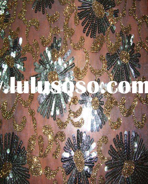cup spangle embroidery on 100% polyester mesh fabric