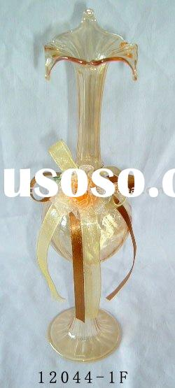 mouth blown glass vase, with fabric flower on the body of vase