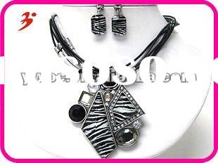 Animal print and crystal deco geometric pendant and multi cord necklace earring set