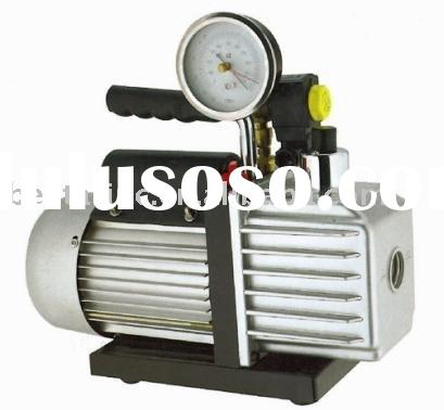 Double stage vacuum pump with gauge