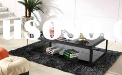modern glass coffee table with spray-painted steel frame