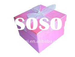 Pink color paper gift box with ribbon