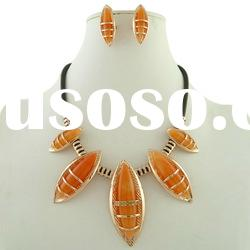 orange resin and rhinestone jewelry set with string chain, necklace and earring