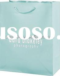 glossy baby blue color luxury paper bag with cotton handle