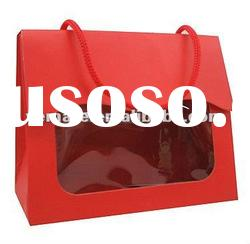 Red color printing cardboard packaging box with handle with clear transparent window on front