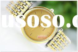 Stainless steel men's watch with gold strap