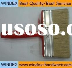 red wall paint brush