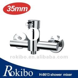 Brass single lever wall mounted bath/shower mixer