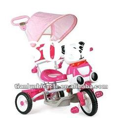 cute pink colored baby tricycle