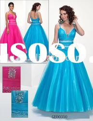 Evening gown features beaded straps and ball gown skirt