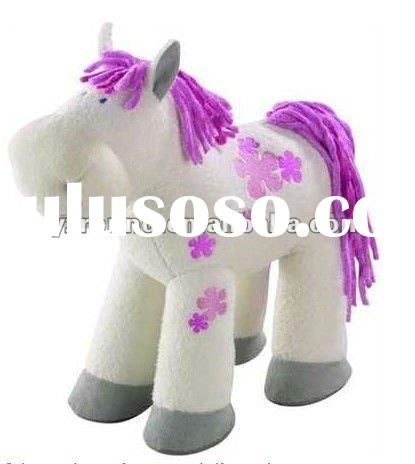 white pony with purple horsehair plush toys